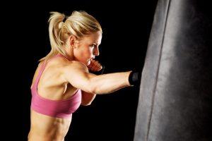 Women using punching bag