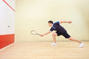 Squash court and player