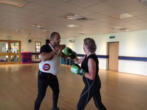 person-trainer-doing-boxing-training-with-customer
